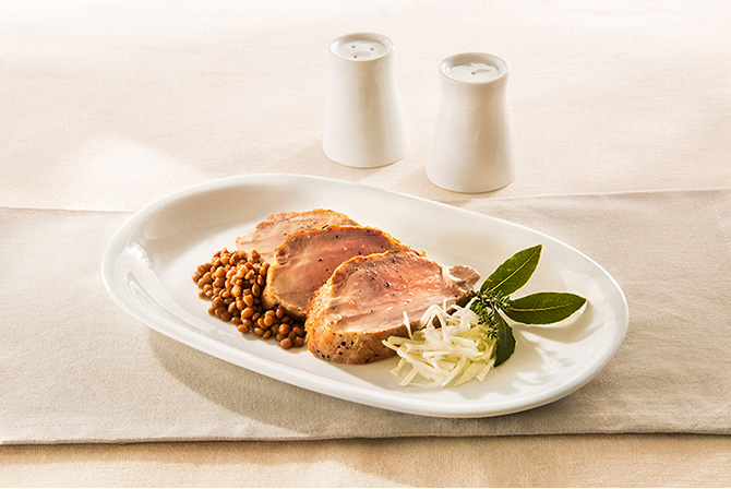 Marinated pork fillet with lentils and cabbage